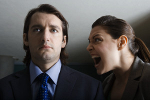 Businesswoman Shouting at Businessman