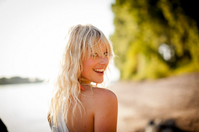 Portrait of blond woman in summer