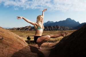A young woman making a beautiful dance pose outside of the Great Sand Dunes National Park in Colorado