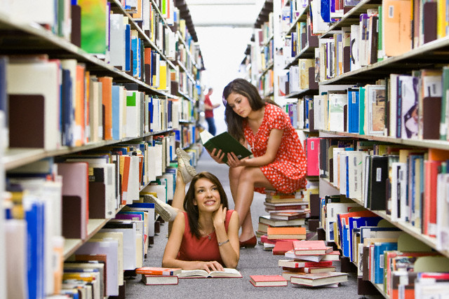 Young Women Reading in Library
