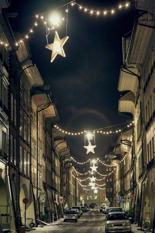 30 Dec 2005, Lausanne, Switzerland --- Night time view of christmas star lights in street, Lausanne, Switzerland --- Image by © Gu/Corbis