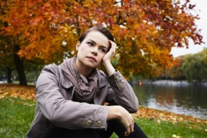 Portrait of woman in park --- Image by © Silke Woweries/Corbis