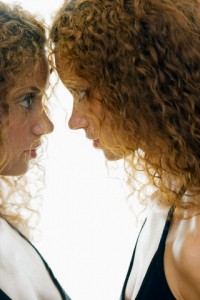 Woman Confronting Herself in Mirror