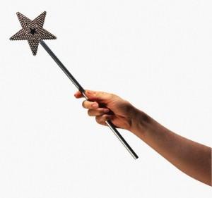 Hand Holding a Star-Shaped Magic Wand