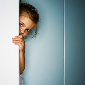 Girl Hiding Behind Door