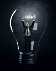 Businessman holding luminous message inside lamp