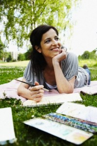 Mid-adult woman painting in park