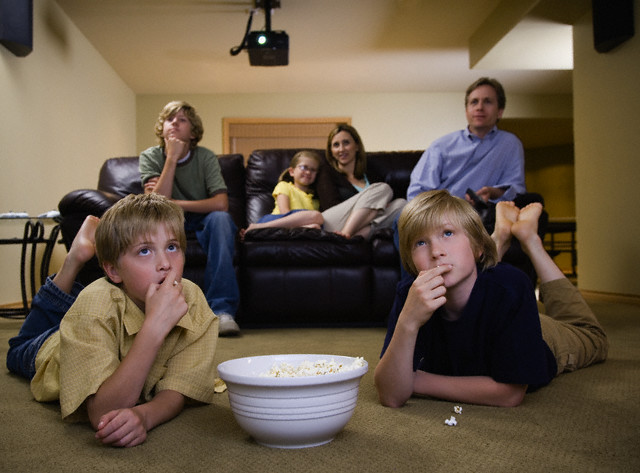 Family Watching a Movie --- Image by © Corbis