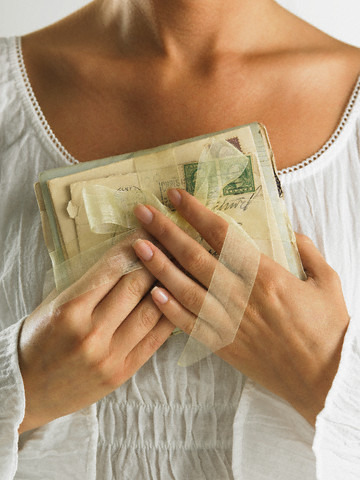 Woman Holding Old Letters --- Image by © Tom Grill/Corbis