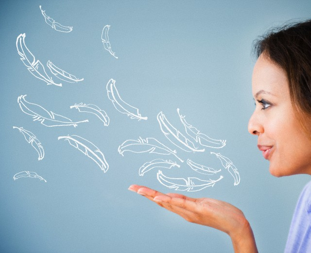 Cape Verdean woman blowing illustrations of feathers